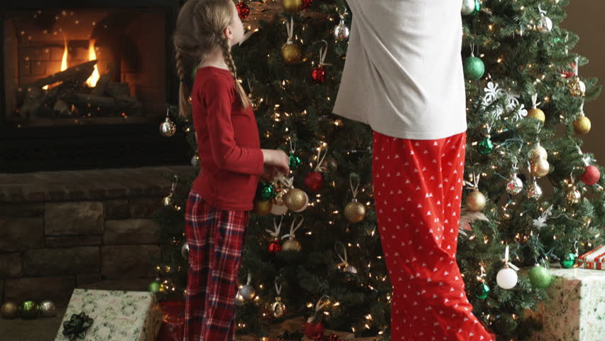 Image result for father and daughter decorating christmas tree