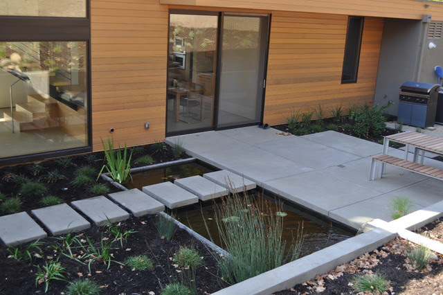 concrete stepping pads, Ipe' deck, water feature, grasses
