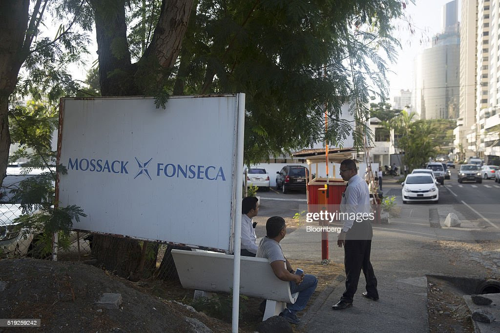 Pedestrians talk near a parking lot outside the building housing the offices of the Mossack Fonseca law firm in Panama City, Panama, on Tuesday, April 5, 2016. For decades, Jurgen Mossack and Ramon Fonseca have been the go-to guys in Panama for international investors looking to put their money in far-flung places. Reports now allege their firm played a critical role in helping political leaders around the world move money offshore. Photographer: Susana Gonzalez/Bloomberg via Getty Images