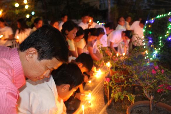 Bishop Pedro M. Torio Jr. (far left) of the Baguio Episcopal area in the Philippines was among those who led the prayers during the candle lighting ceremony in observance of World AIDS Day.
