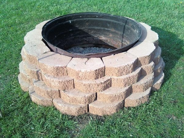 Firepit Made With Castle Rock And An Old Tractor Tire Rim Things To Make Pinterest Tractor