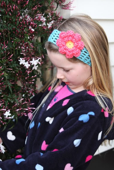 Hazel modelling a crochet headband made for a friend