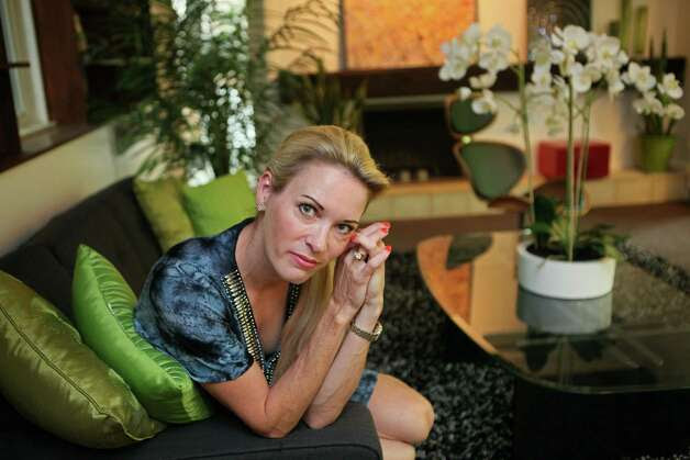 Suzy Favor Hamilton poses for a portrait at her home in Shorewood Hills a suburb of Madison, Wis. in 2012. The three-time Olympian has admitted leading a double life as an escort. She apologized Thursday after a report by The Smoking Gun website said she had been working as a prostitute in Las Vegas. (AP Photo/Milwaukee Journal-Sentinel, Michael Sears) Photo: Getty Images / SL