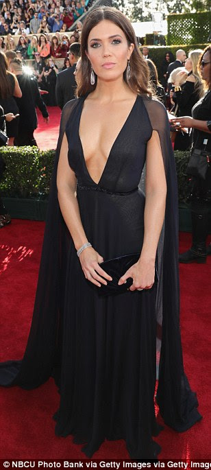 Taking the plunge: Mandy Moore wore a black caped dress with a daringly low neckline