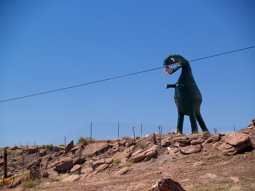Dinosaur eating a mannequin