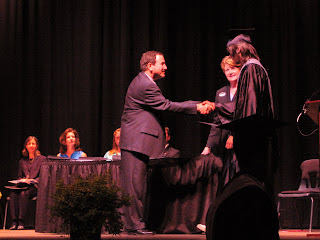 The Boy receives his diploma