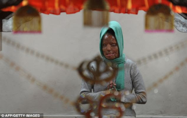 Desperate: Sonali, pictured worshipping at a Sikh temple earlier this month, wrote to the Indian Government earlier this year threatening to kill herself if she didn't receive any state funding for treatment
