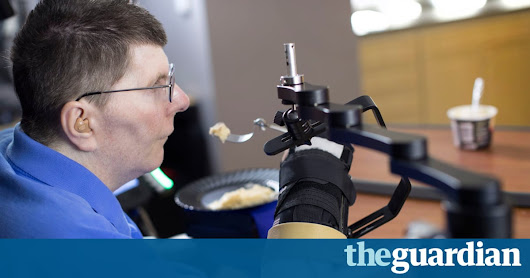 Paralysed man moves arm using power of thought in world first | Science | The Guardian