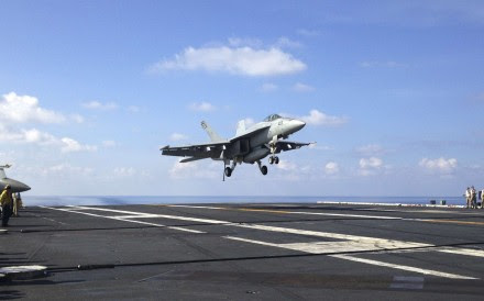 An FA-18 jet fighter lands on the USS John C. Stennis aircraft carrier in the South China Sea. Photo: AP