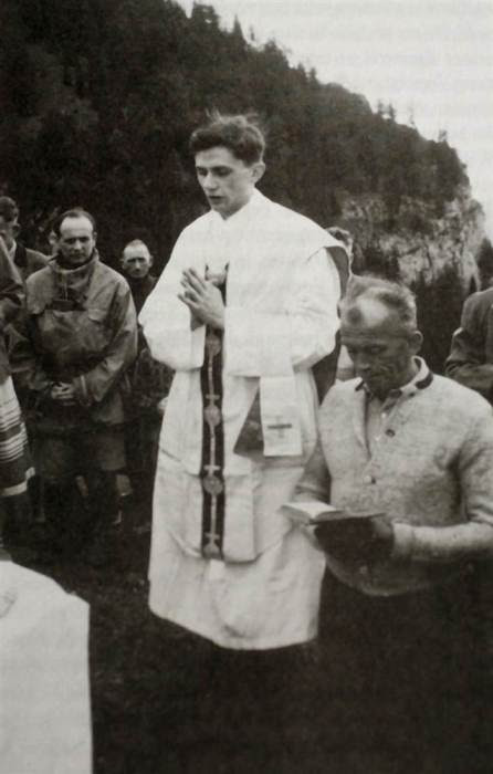 Pope Benedict XVI Joseph Ratzinger celebrates Mass at a mountain site near the Bavarian town of Ruhpolding, Germany in the summer of 1952.