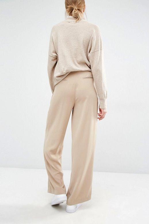 Le Fashion Blog Low Bun Neutral Office Style Oatmeal Turtleneck Knit Tan Wide Leg Pants White Sneakers