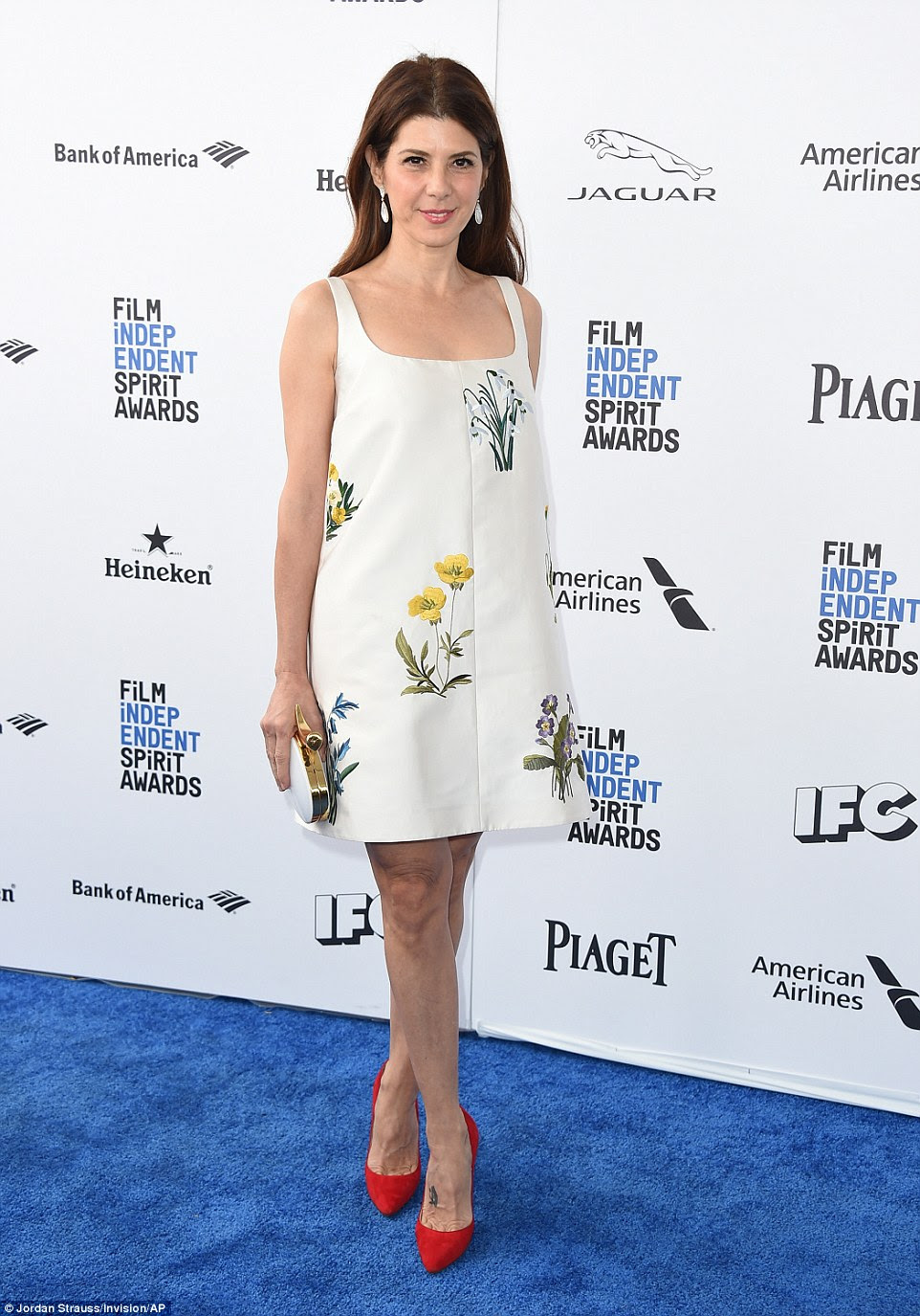 Floral fun: Marisa Tomei looked ready for an Easter brunch in her mini dress with sketches of wild flowers on it and red pumps