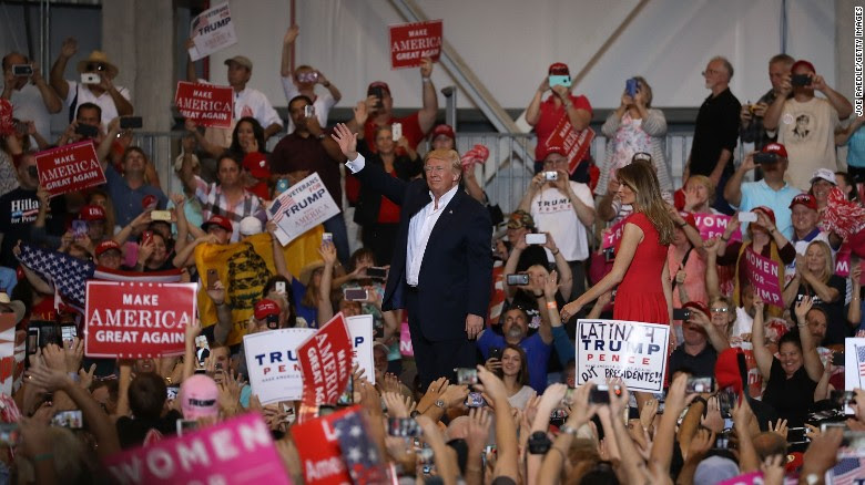 President Donald Trump and first lady Melania Trump stand together during a campaign rally on February 18, 2017 in Melbourne, Florida.