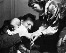 Gregory Bateson with baby Mary Catherine 1940. Photo by Jane Belo.
