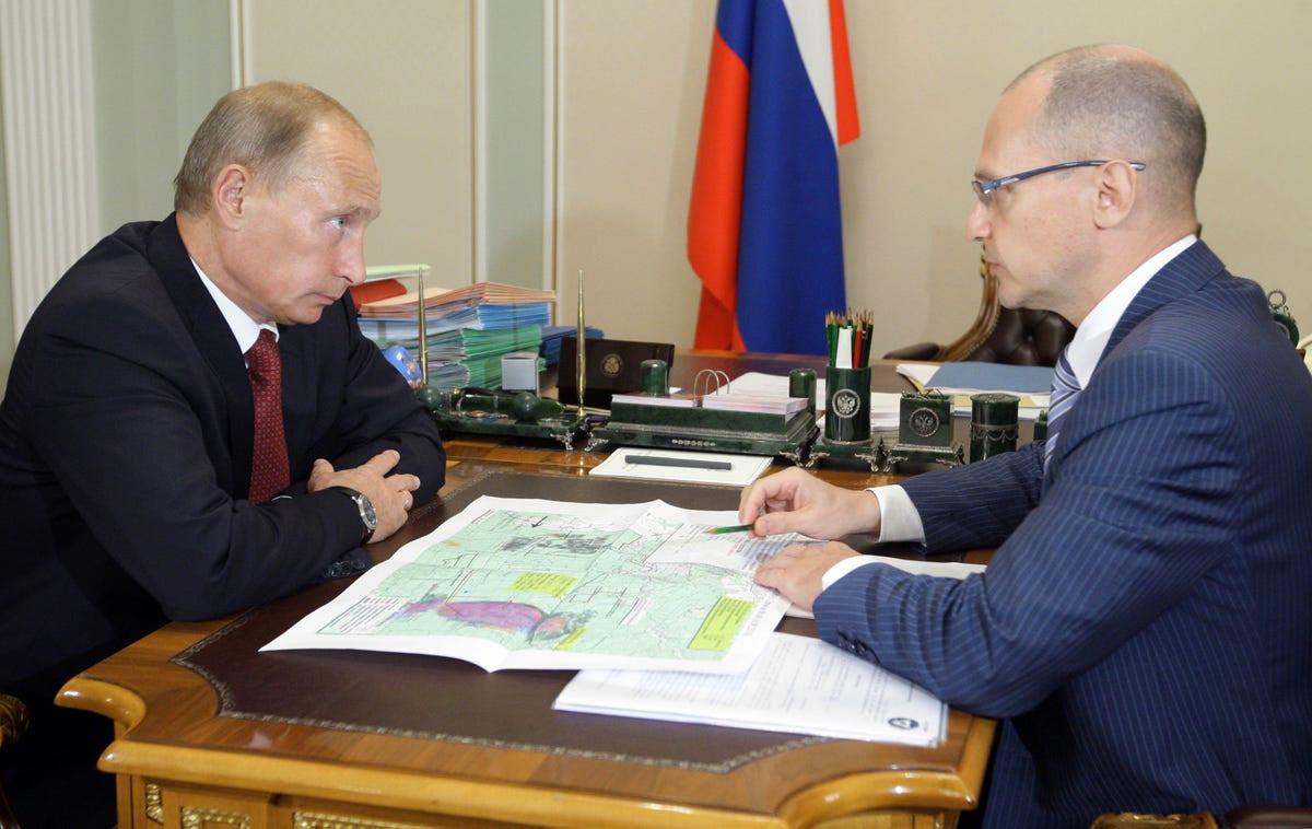 Russia's Prime Minister Vladimir Putin (L) meets with Chief of Russian state nuclear corporation Rosatom Sergei Kiriyenko
