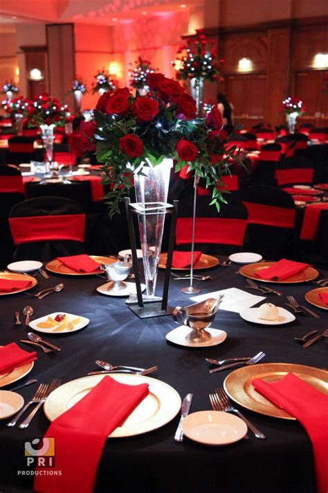 Black tie Motown event with classic red rose centerpiece