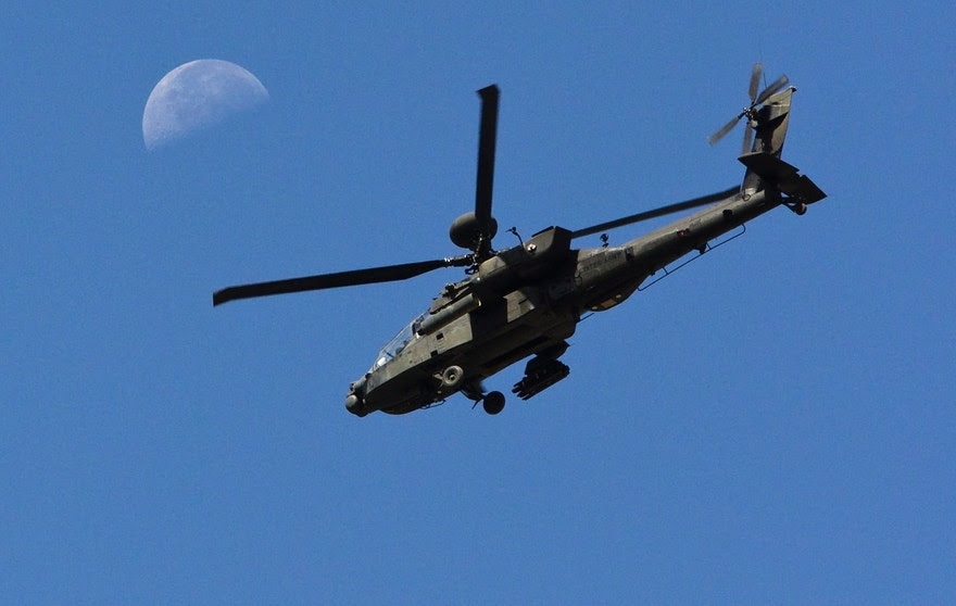 A U.S. Army Apache flies past the moon in the Zharay district of Kandahar province, southern Afghanistan June 11, 2012.  REUTERS/Shamil Zhumatov  (AFGHANISTAN - Tags: MILITARY CIVIL UNREST CONFLICT) - RTR33FX7