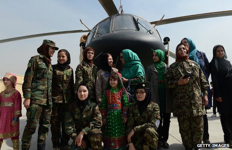 Latifa Nabizada and other women in front of a helicopter
