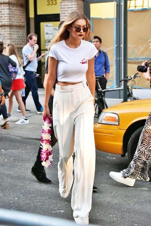 Le Fashion Blog Model Style Gigi Hadid Round Sunglasses Dark Burgundy Lipstick Embroidered White Tee Ivory High Waisted Wide Leg PantsVia Popsugar