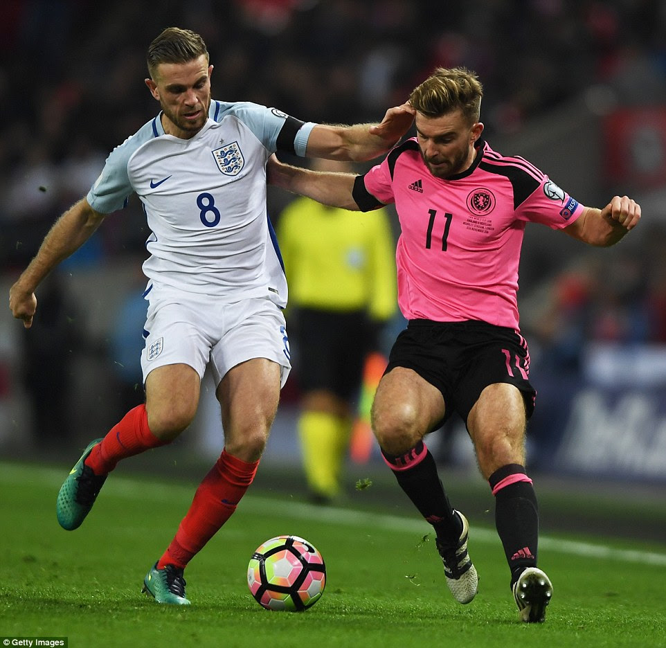 Henderson and Morrison battle for the ball during the World Cup qualifier that England won to stay top of the group