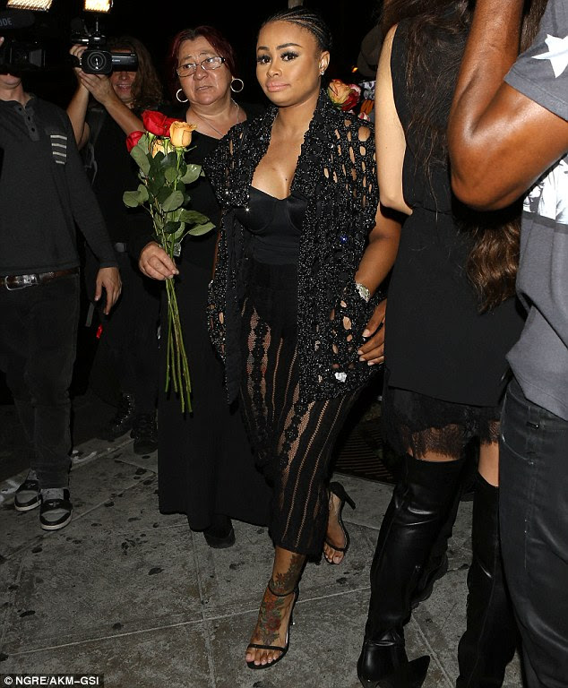 Tattooed lady: Blac's revealing ensemble showed off her tattooed legs as she emerged from the venue after a night of partying