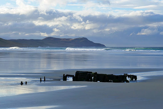 Wreck and wave at low tide in Machir Bay, Isle of Islay
