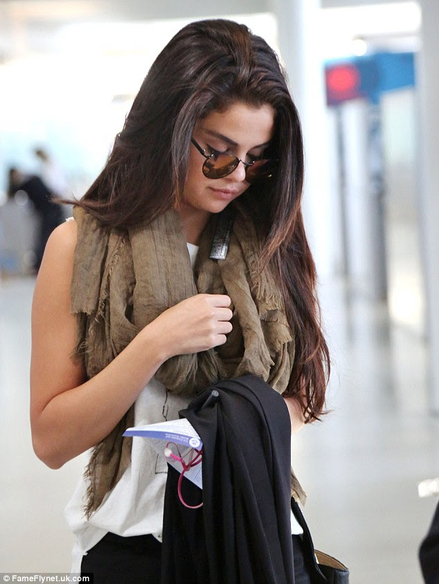 Where's Justin? Selena Gomez looked downcast as she left the Toronto airport by herself on Sunday after being spotted arriving with Bieber the day before