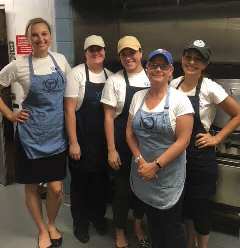 Staff Members Volunteer at The Downtown Mission