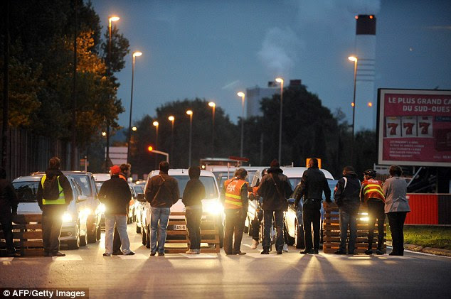 Workers block traffic in Toulouse southern France