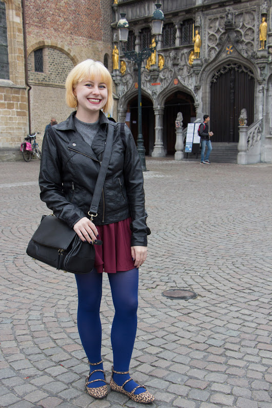 Outfit: Blue Tights, Maroon Skirt, Leather Jacket, and Leopard Flats