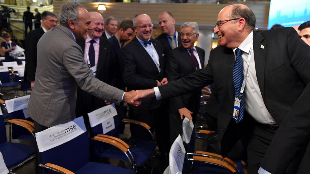 Israeli Defense Minister Yaalon shakes hands with former Saudi intelligence chief, Turki al-Faisal. (Photo: Ariel Harmoni/ Israel Defense Ministry)
