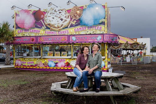 Cloudy boardwalk amusement engagement shoot | Equally Wed