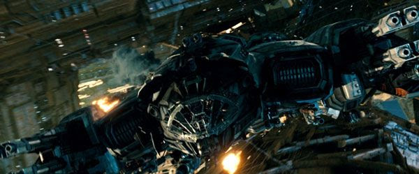 The Ark attempts to evade two Decepticon fighters chasing it across Cybertron in TRANSFORMERS: DARK OF THE MOON.