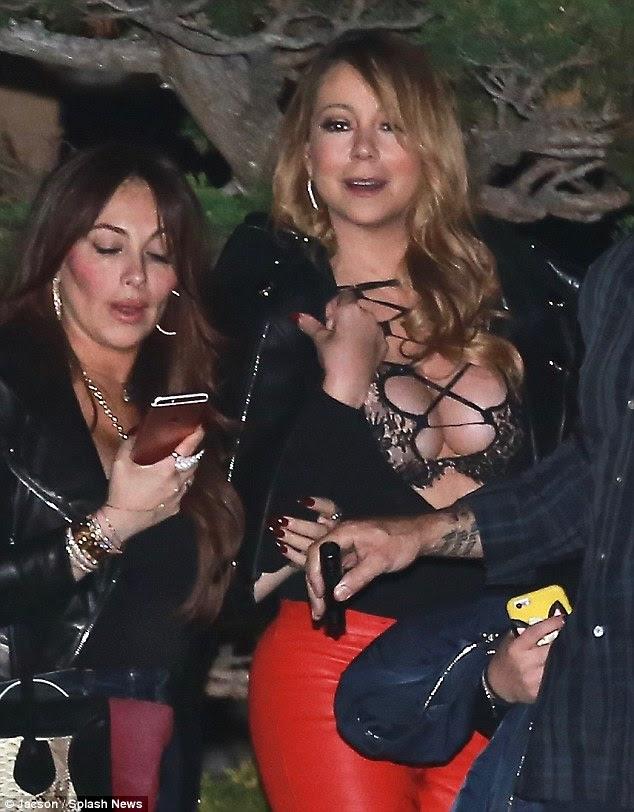 Can not Let Go!  Mariah Carey ainda estava usando seu anel de noivado, quando ela saiu para jantar no celebridade hotspot Nobu em Malibu na quinta-feira à noite, desfrutar de um catch up com os amigos