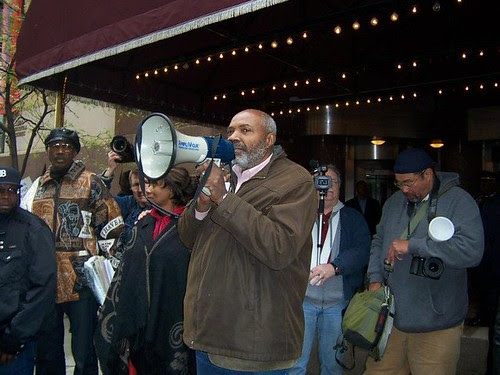 Abayomi Azikiwe, editor of the Pan-African News Wire, covering the demonstration against Bank of America on October 21, 2011. Occupy Detroit adopted the Moratorium NOW! demand for a halt to foreclosures. by Pan-African News Wire File Photos
