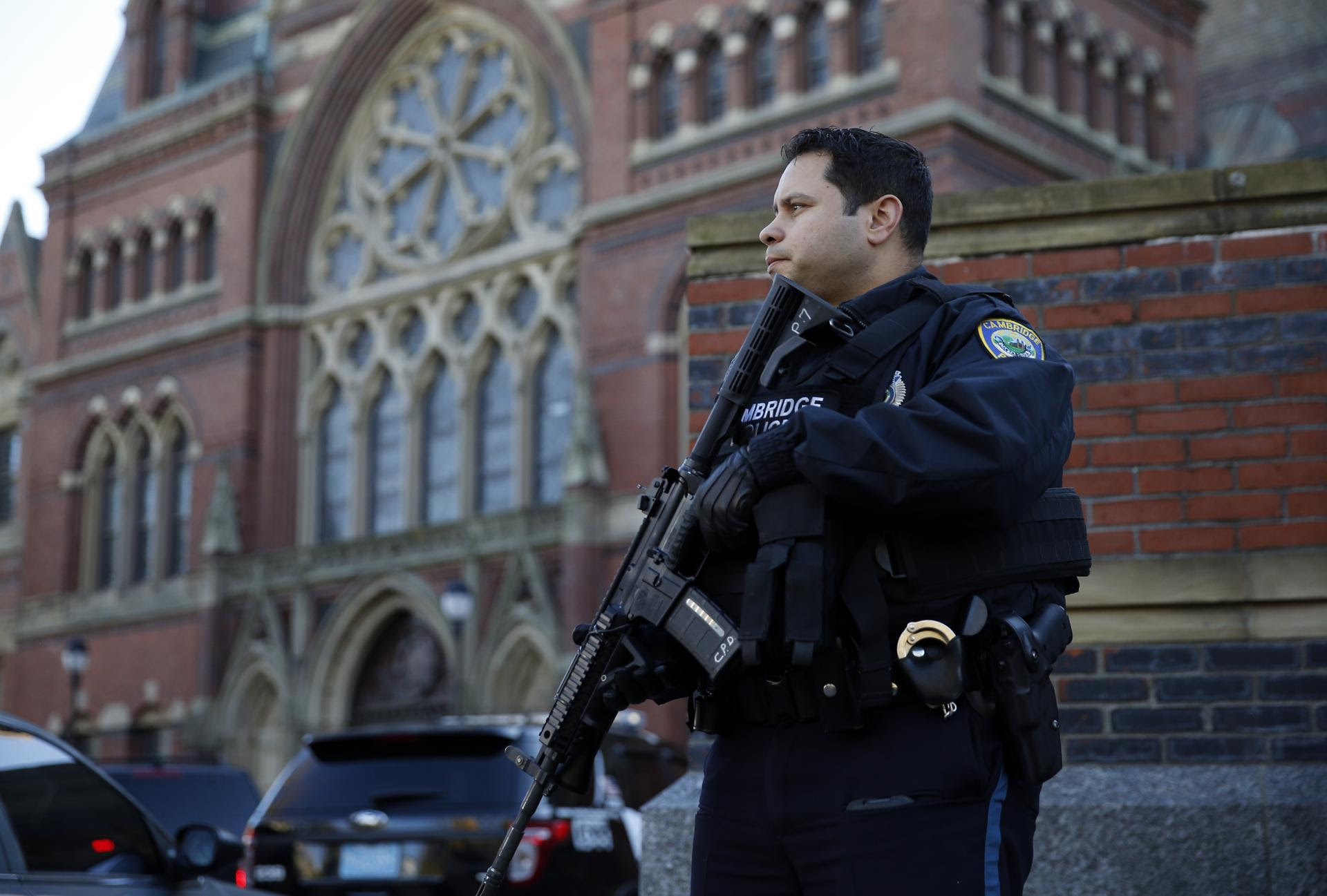 A Cambridge police officer kept watch outside of Harvard's Memorial Hall on Monday.