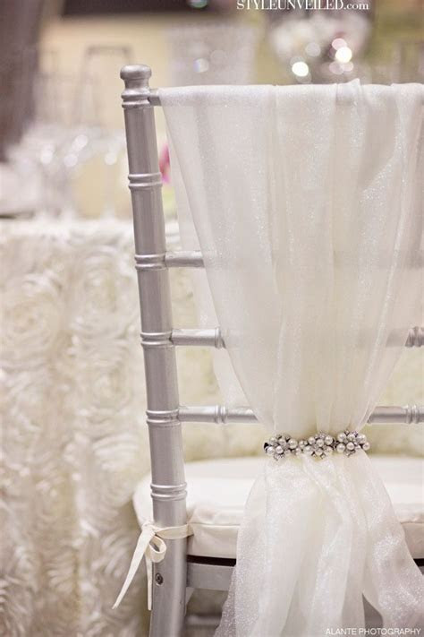 Tulle and sparkly chair cover.