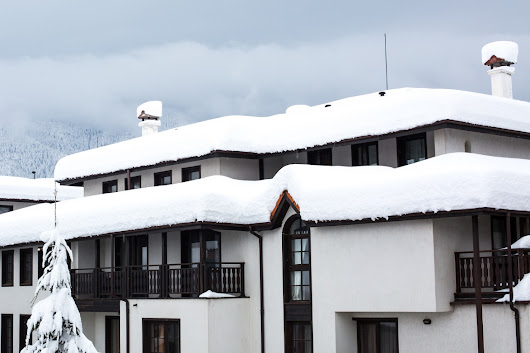 Surrey Roofing Tips: How to Manage Snowfall on a Flat Roof Efficiently
