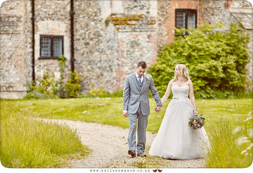 Bride and groom walking down path at Butley Priory - www.helloromance.co.uk