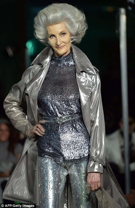 A breathtakingly chic senior model rocks all over silver to match her bouffant 'do