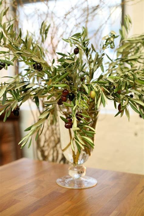 Love the idea of olive branches as greenery for floral