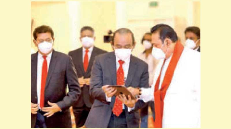 Prime Minister Mahinda Rajapaksa participating at the foundation laying ceremony, from Temple Trees via video technology, for the new People's Bank headquarters to be built at Ibbanwala Junction in Colombo.