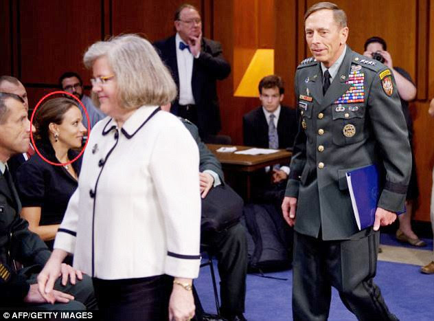 Palace coup: Petraeus, seen here with wife Holly as Broadwell looks on, fell victim to his powerful enemies inside the CIA, the authors claim