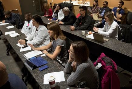 World-class expertise from every angle: A roomful of specialists meet weekly for children with brain tumors