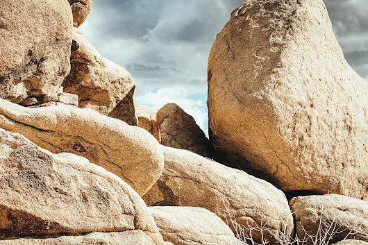 Reflective Joshua Tree Rocks by Amyn Nasser