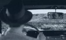 Shamus checks the rear view mirror