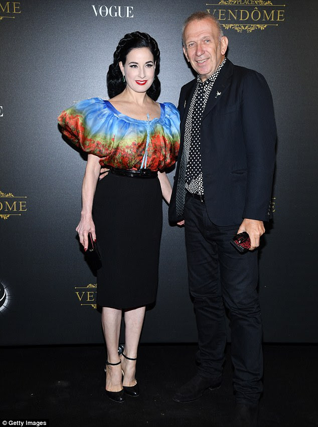 Twosome: Dita Von Teese showed off her famous curves in a sexy number as she cosied up with designer Jean-Paul Gaultier