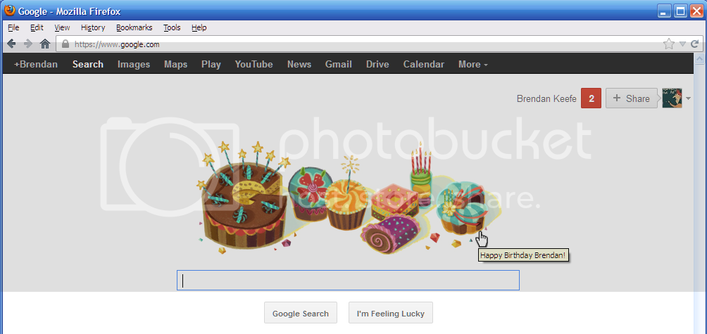 Google's home page, showing birthday cupcakes and hover text greeting me