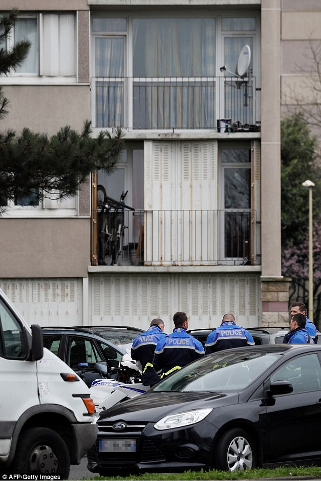 Police officers investigate at the home ofZiyed Ben Belgacem, who was shot dead at Paris Orly airport this morning