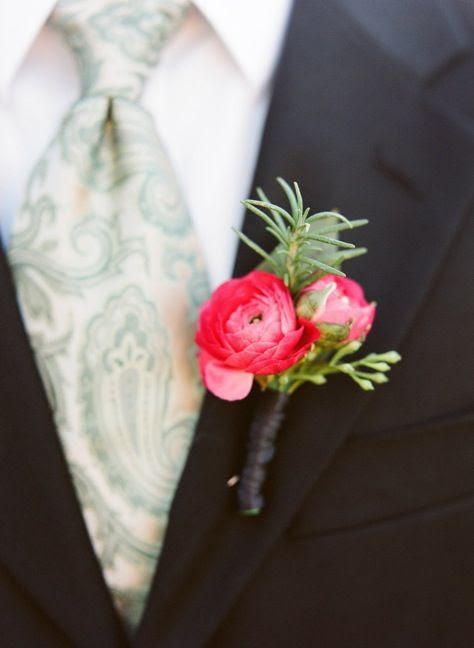 The boutonnieres and corsages will be wine-colored ranunculus with green rosemary wrapped in gunmetal gray ribbon with the stems showing.